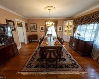 Dining room table with 8 chairs.