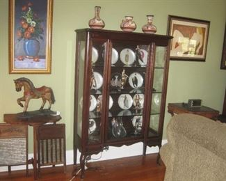3 Sided glass china cabinet w/Erte figures/plates and original artwork.
