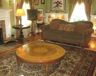Large round coffee table and sofa.
