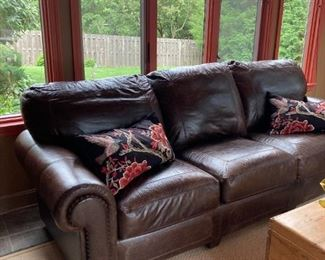 Fabulous 8 foot Stickley Craftsman leather sofa with stamped/woven trim and nail head detail