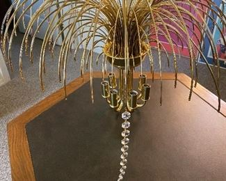This is a waterfall Chandelier. The crystals will be located at the front desk. I put one Crystal on there so you can see what  they look like.  This is a stunning piece. Hollywood Regency at its finest