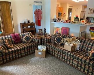 The sofa and loveseat they have would arms that match the end table and then nesting tables