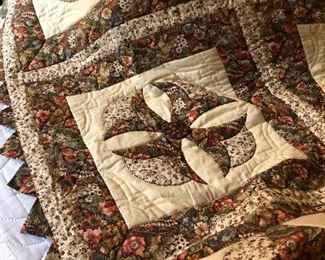 Handmade vintage quilt with matching pillows