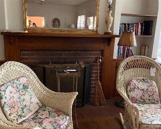 Wicker chair, wicker rocker, brass plant stand, fireplace screen, mirror, lamps