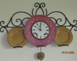 THE CLOCK IS SEPARATE AND THE DISHES ARE AS WELL. THE WROUGHT IRON FIXTURE IS ON ITS' OWN
