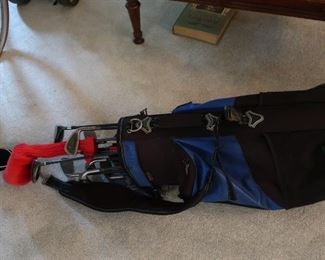 older  golf  clubs  and  bags