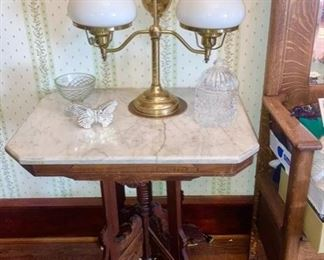 Antique marble top parlor table, marble is cracked, vintage brass 2 light lamp w/ milk glass shades