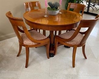 Berdimeyer table and chairs comes with two extra leafs