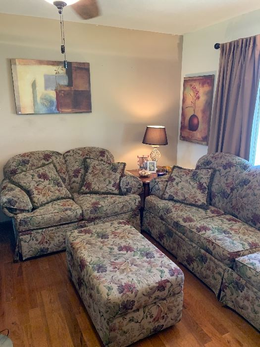 Floral sofa sleeper, loveseat and ottoman.