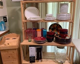 Wood Bakers rack, wood trashcan, pottery dishes, Corelle dishes, large jar with nozzle, Tupperware and other kitchen items
