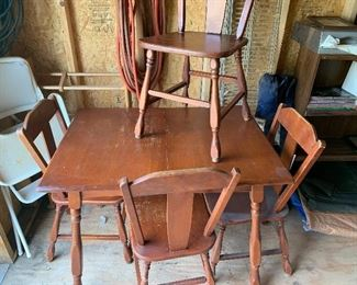 Antique table with four chairs