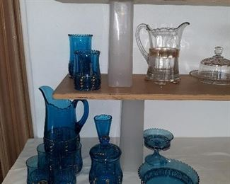 Blue and gold glassware salt and pepper shakers pictures and a covered Bowl.