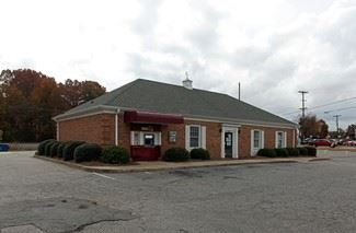 The sale will be held in this former bank building on the corner of Cox Rd and Ozark