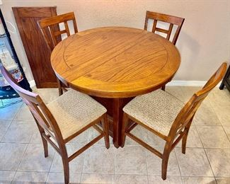 """$480 Ashley Home, Cross Island Tall Pub table with 1 leaf + 4 counter height bar stools.  Table: 42""""diameter x 36""""tall + 18"""" leaf Chairs: 17"""" x 18"""" x 40.5""""back height Seat Height: 23.5"""""""