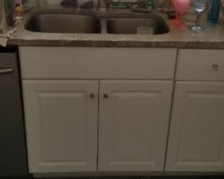 Clean & nice kitchen cabinets; stainless steel sink & faucet
