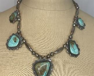 """Statement Piece 22"""" long silver beaded necklace with 5 large greenish turquoise pendants with the largest being 1.5"""" by 1.75""""  and the smallest being 1"""" by 1 1/8"""". $500"""