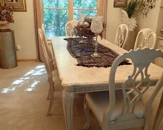 LARGE WHITE TABLE WITH LEAVES AND CHAIRS