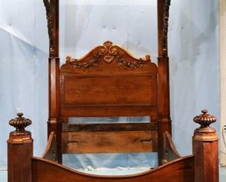 085a - Rosewood rococo half tester plantation bed with roses carved on arm supports, carving on headboard and tester crest, attrib. to Prudent Mallard, 9 ft. T, 56 in. W, 77 in. L.