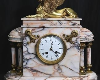 039a - French marble clock with gold sphinx on top, 16.5 in. T, 15 in. W, 6 in. D.