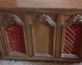Working stereo console which plays 8-tracks, LPs and radio.