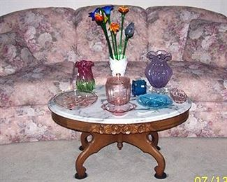 Sofa, marble top table, pink depression glass, glass lowers