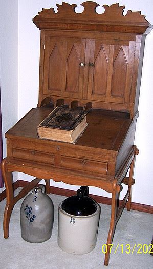 Early desk, 3 gal. jug w/ cobalt flower, two tone jug and early Bible