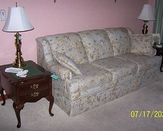 Sofa, two end tables and brass lamps