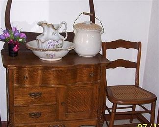 Commode w/ towel bar, pitcher and bowl (damaged), cane bottom chair
