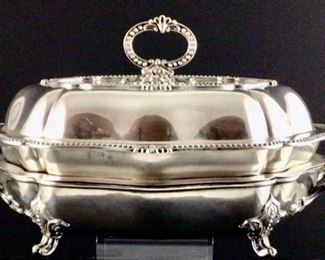 Old chef filled silver plate entrée dish with warming stand. Four piece said early 20th century.