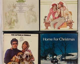 Multiple reel to reel tapes. Shown here: Ray Conniff, you are the sunshine of my life; Percy Faith the entertainer; the captain and Tennille, Love will keep us together;  and home for Christmas, multiple artists.