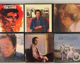 Multiple reel to reel tapes. Shown here: The body and soul of Tom Jones; Paul Lanka, feelings; Neil diamond, serenade; Andy Williams, the way we were; Paul Simon, greatest hits; The happy sound of Ray Conniff
