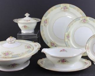 Noritake 1945– 11 dinner plates, 11 salad plates, seven dessert bowls, gravy boat with attached under plate, sugar bowl with lid, covered vegetable bowl.