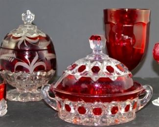 George Duncan & sons red cut to clear crystal butter dish. Pictured front left flashed Ruby 1901 Pan Am Airlines cut crystal(2), pictured front left Nachtmann ruby cut to clear  Liqours set of nine from west Germany.  pictured back left vintage ruby cut to clear crystal pedestal with lid candy jar. Pictured back right Arlington by Mosser red ice tea glass.