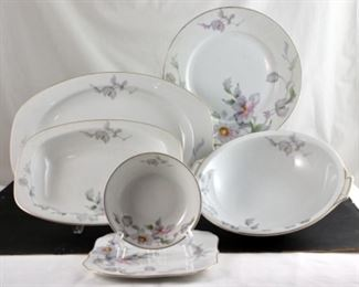 Thun Dinnerware-12 dinner plates, 12 square salad plates, 11 saucers, nine dessert bowls, one platter, two oval vegetable bowls, one round serving  bowl.