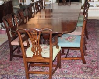 Another view:  Regency Mahogany 3 Pedestal 12' Dinning Table with 12 Chippendale Chairs (10 Side Chairs & 2 Arm Chairs). Originally belonging to Herman & Margaret Brown