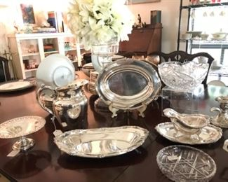 Table Top View  of Collection of various Silver Plate serving pieces, etc.