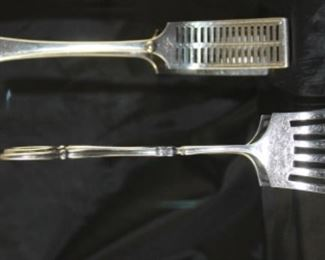 Back picture: Atkins brothers silver company 1853 to 1925 antique tongs. Front: Barker Brothers England antique electroplated nickel silver tongs Scissor Style.