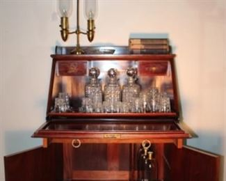 Antique Drop-front Bar with Original Crystal Showing Interior with original American Brilliant Cut Period Crystal:  (3) Decanter, (1) Highball, 5 Rocks, 4 Whiskey, 5 Shot glasses