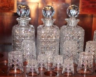 Close up of original Crystal Antique Drop-front Bar with Original Crystal Showing Interior with original American Brilliant Cut Period Crystal:  (3) Decanter, (1) Highball, 5 Rocks, 4 Whiskey, 5 Shot glasses