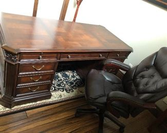 front of desk with  nice leather office chair