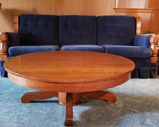 Cut down round oak table now a coffee table & wood trim sofa