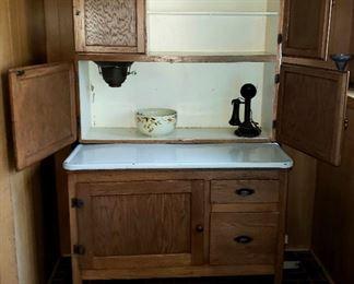 Hoosier cabinet door open, set Hall bowls & vintage phone