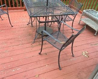 Pretty outdoor wrot iron furniture table chairs and umbrella $350
