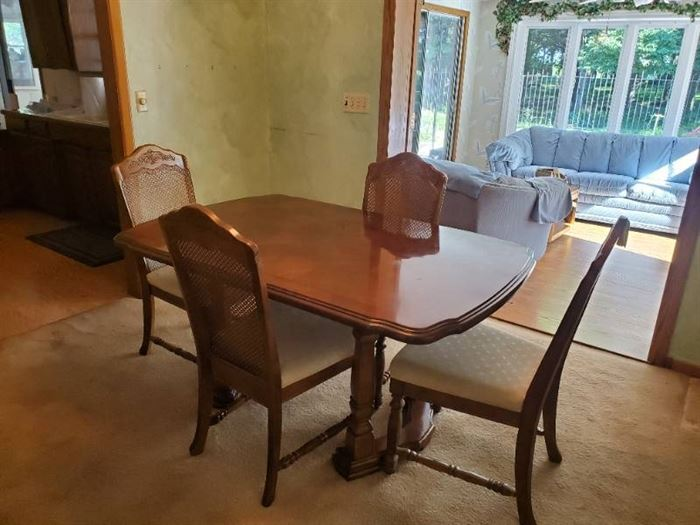 """Dining room table w/4 matching cane back chairs 29"""" H X 61"""" X 40"""" W"""