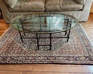 "Glass cocktail table, 44""L x 31""W x 16""H,  $255.  Wool rug, 46""W x 6',  $165"