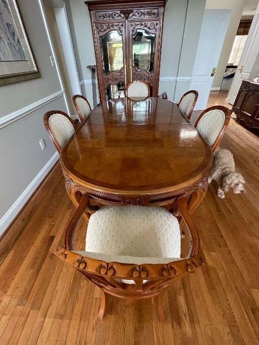 Century dining room table with 8 matching chairs and 2 leaves