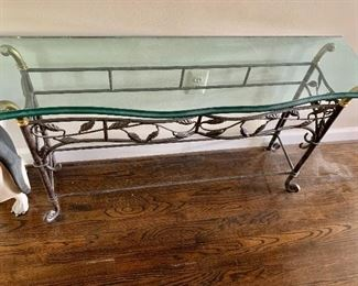 Glass topped console with wrought iron and brass base