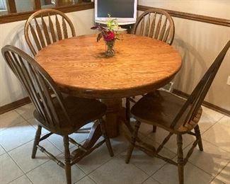 pedestal table with 5 chairs and a leaf