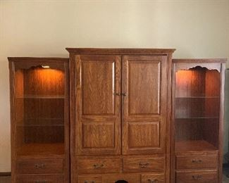 Entertainment center with two lighted shelf units