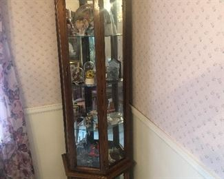 Glass tiered curio cabinet with lighting